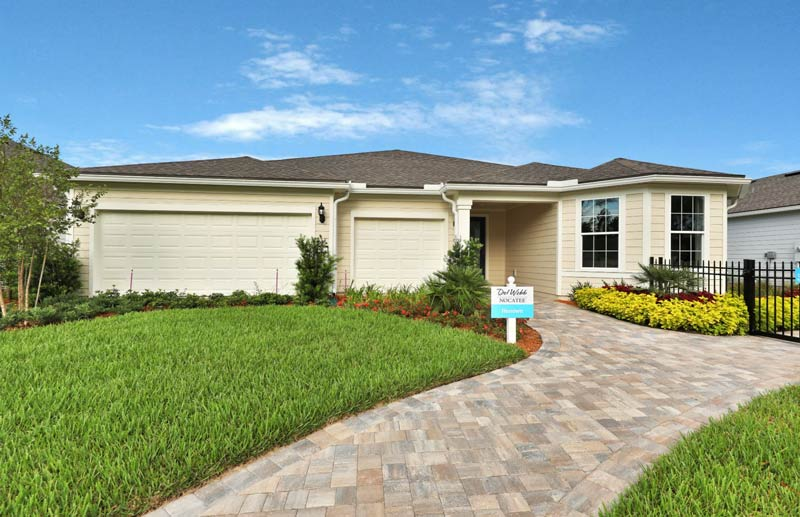 Single family home for sale in Nocatee, with a nice green yard and clear blue sky.